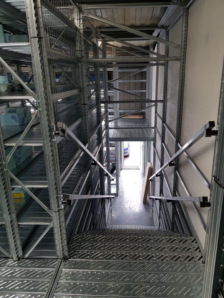 Multi tiered shelving mezzanine